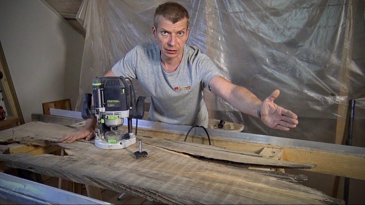 На фото фрезер FESTOOL OF 2200 для обработк слеба дерева куска спила